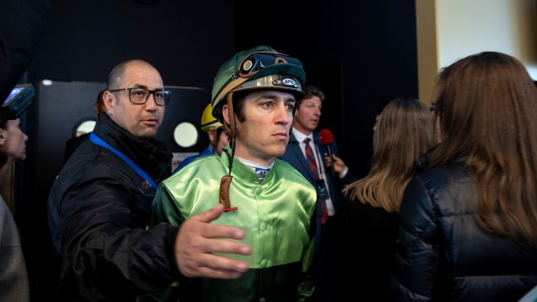 Man in the middle: Christophe Soumillon heads out to ride Barkaa in the Poule d'Essai des Pouliches after leading protests against the state of the racing surface at Longchamp