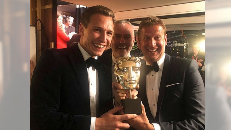 From left to right: Oli Bell, Paul McNamara and Ed Chamberlin celebrate with their Bafta