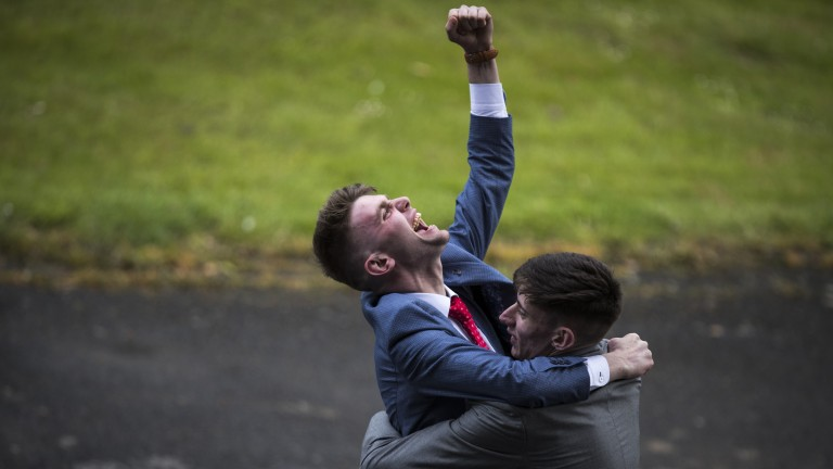 A punter punches the air after picking the winner of the 1m1½f fillies' maiden won by Aiseolas at Gowran Park on Wednesday
