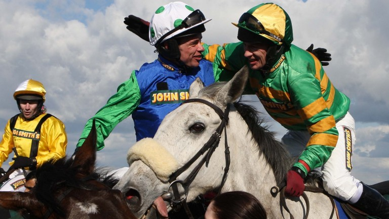 Timmy Murphy (left) is congratulated by Paul Carberry after winning the Grand National on Comply Or Die