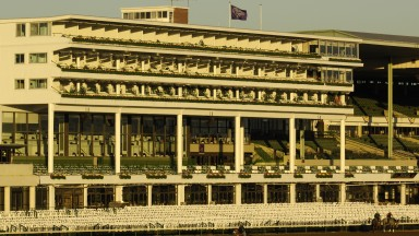 The grandstand at Monmouth Park hit by the first sun rays of the day