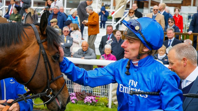 Adam Kirby: gives Harry Angel a pat after winning the Duke Of York