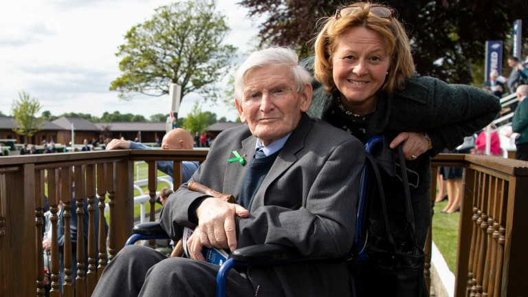 Peter Beaumont, pictured at York with Injured Jockeys Fund almoner Helen Wilson, is 84