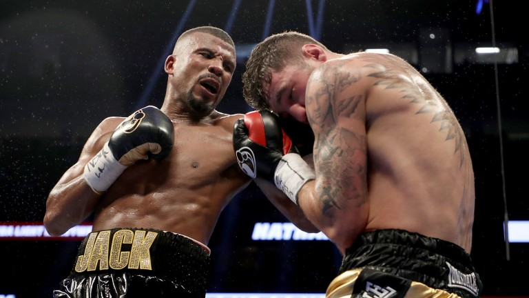 Badou Jack throws a punch at Nathan Cleverly