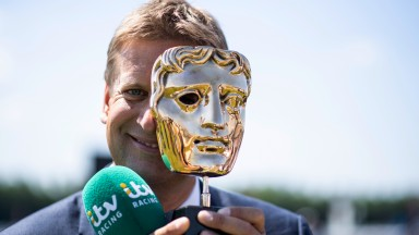 ITV Racing presenter Ed Chamberlin poses with their Bafta