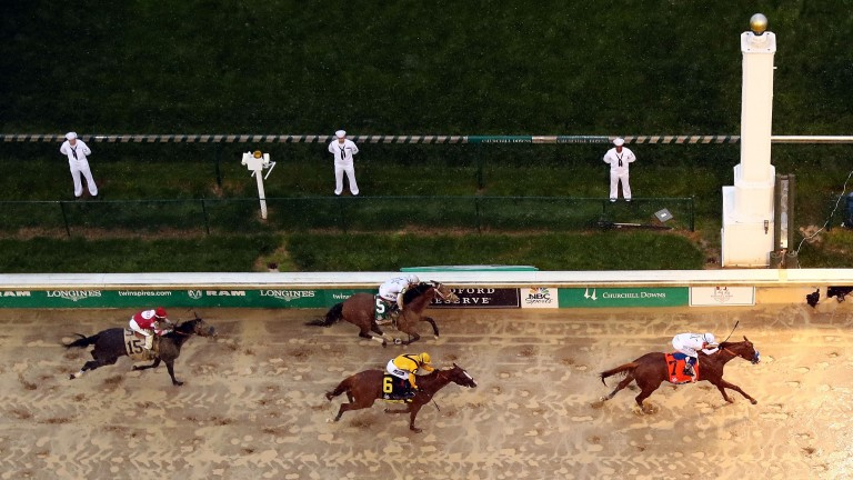 Justify and Mike Smith stretch away from Good Magic (yellow) and Audible to win the Kentucky Derby
