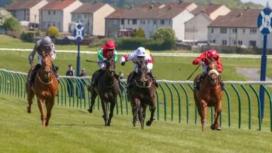 Boundary Lane (right) makes a winning debut in the 6f fillies' novices stakes at Ayr