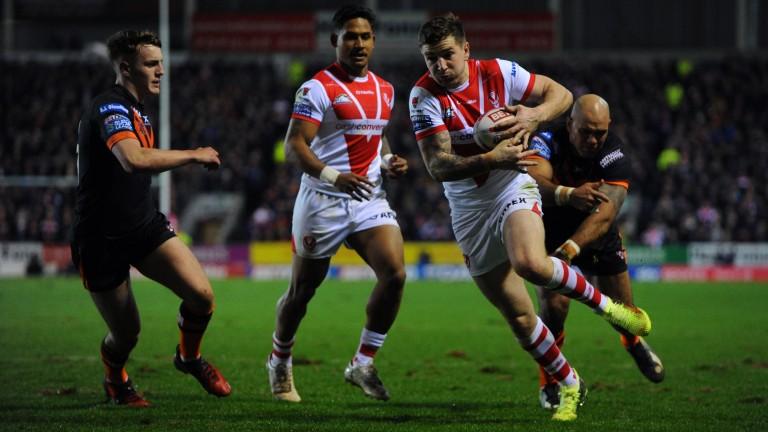 Saints' Mark Percival breaks through the Castleford defence to score