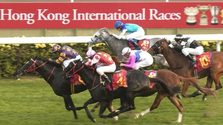 Olympic Express, formerly Ecclesiastical, wins the 2002 Hong Kong Mile after his move from Newmarket and a change of name