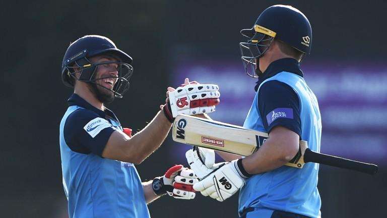 Alex Hughes and Daryn Smit celebrate Derbyshire's win over Durham