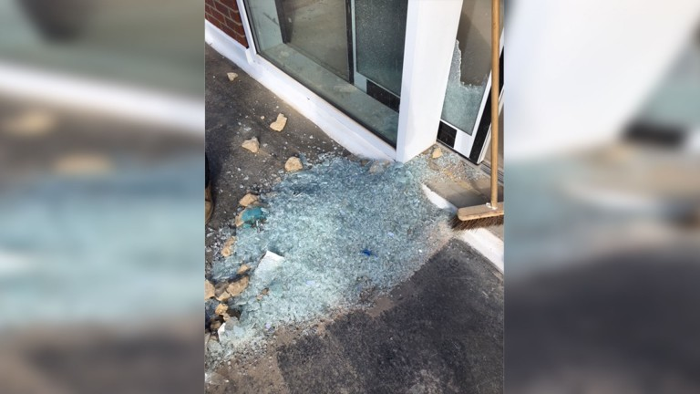 A pile of glass on the first floor of the building. Vandals reportedly threw rocks from below
