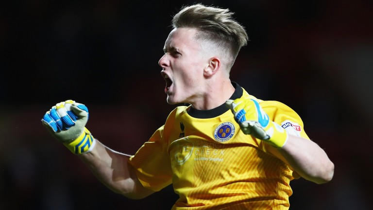 Shrewsbury goalkeeper Dean Henderson celebrates the semi-final win over Charlton