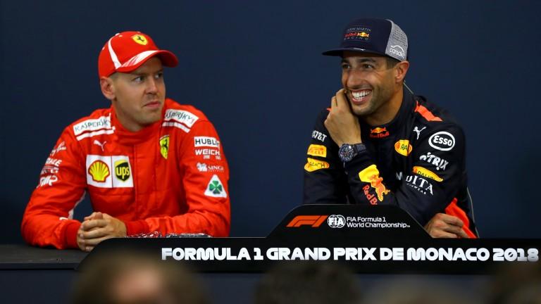 Daniel Ricciardo is all smiles after taking pole in Monaco while Sebastian Vettel (left) looks on