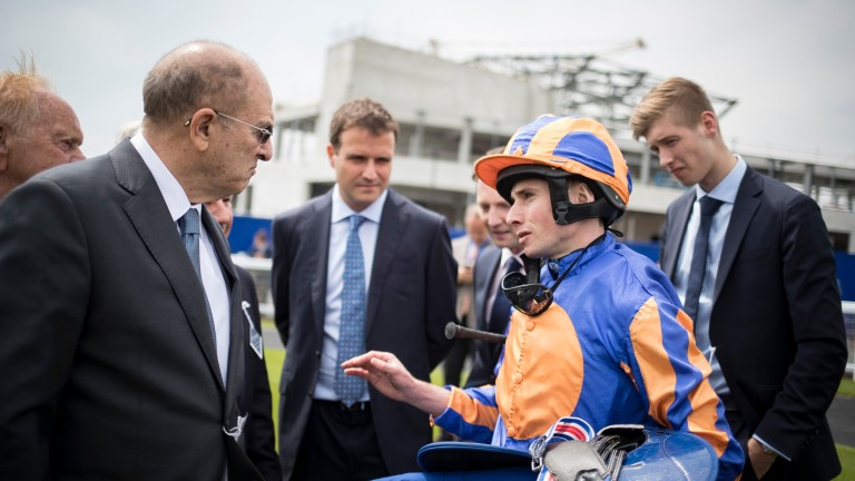 Debrief: Michael Tabor listens to Ryan Moore after Just Wonderful's victory in the opener