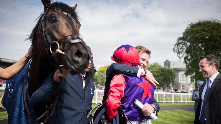 Celebration time: Ken Condon embraces Shane Foley after Romanised's Classic victory