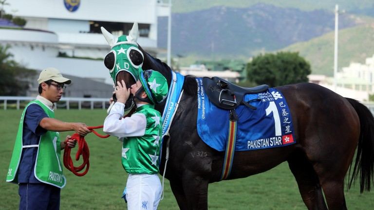 Tommy Berry kisses Pakistan Star after his Group 1 victory