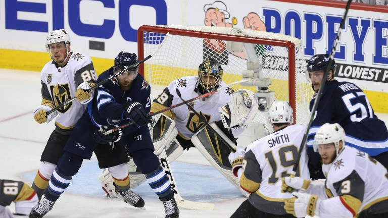 Vegas Golden Knights defend their goal against Winnipeg Jets