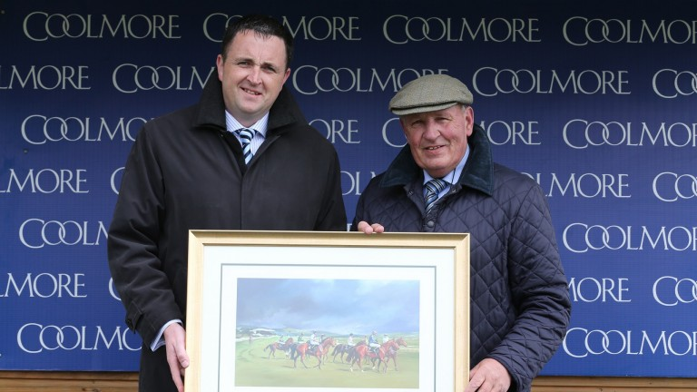 Gerry Aherne (left): the breeder of Romanised on trophy presenting duty for Coolmore