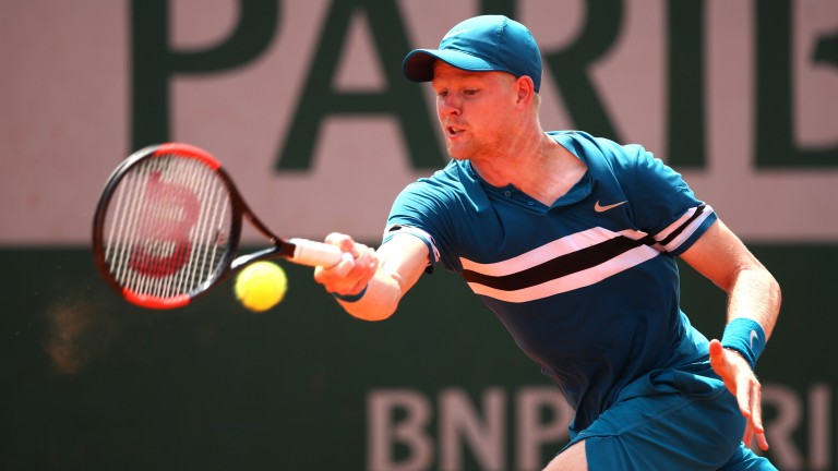 Kyle Edmund on his way to defeating Marton Fucsovics 6-0 1-6 6-2 6-3 in round two