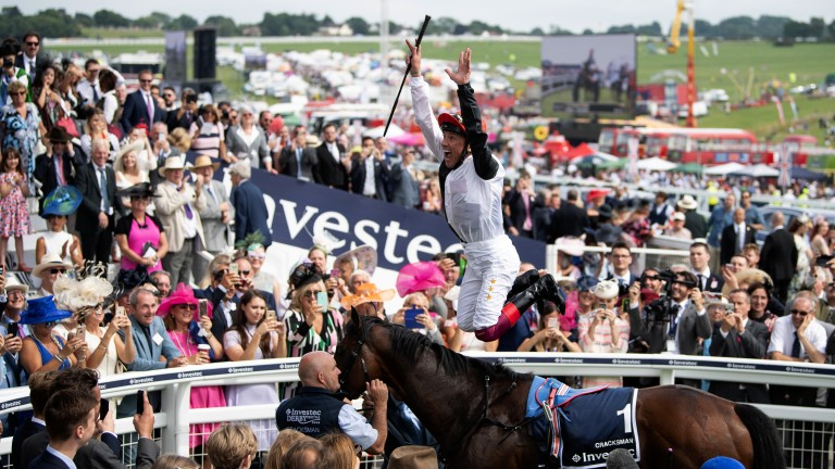 Flying Frankie: Dettori entertains the crowd with his famous dismount after Cracksman's Coronation Cup win