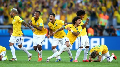 Brazil celebrate after beating Chile in a penalty shootout at the 2014 World Cup