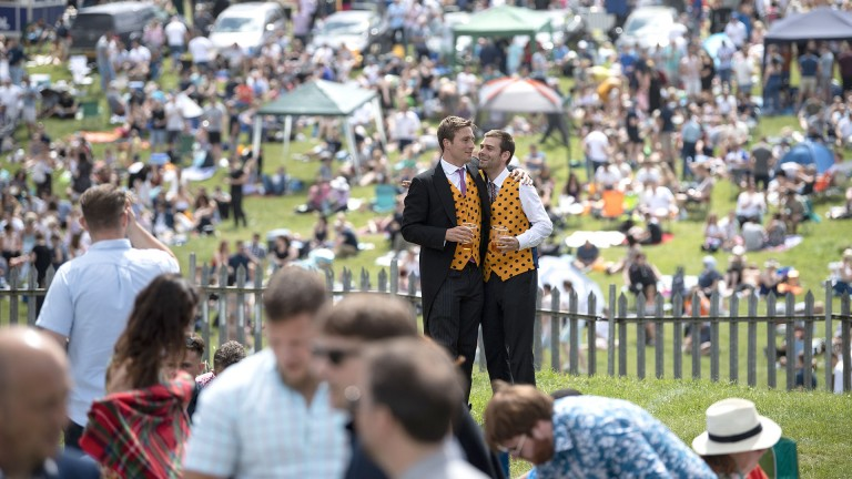 This is the life pal: racegoers in matching waistcoats take in the pre-race atmosphere