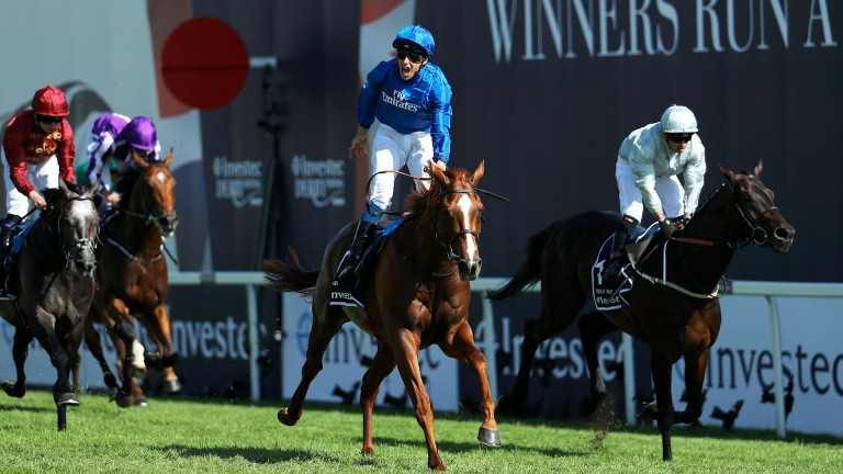 Joy for Buick: William Buick lets out a big roar as he wins the Investec Derby on Masar