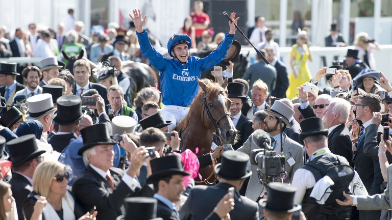 We are the champions: William Buick takes the ovation from the crowd as he and Masar are led back into the hallowed winner's enclosure