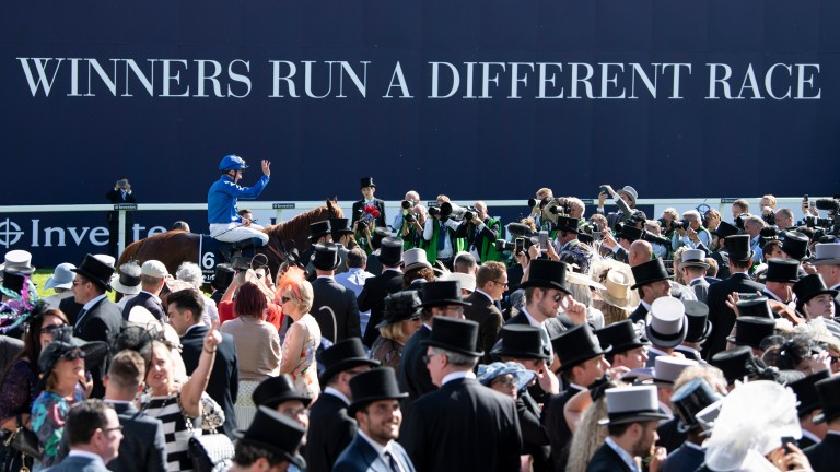 Centre of attention: William Buick and Masar after winning the Derby