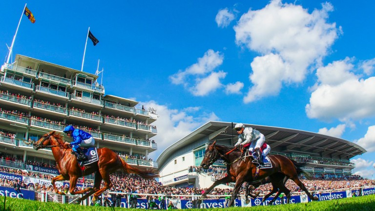 Masar and William Buick win the Derby in front of packed stands, under blue skies