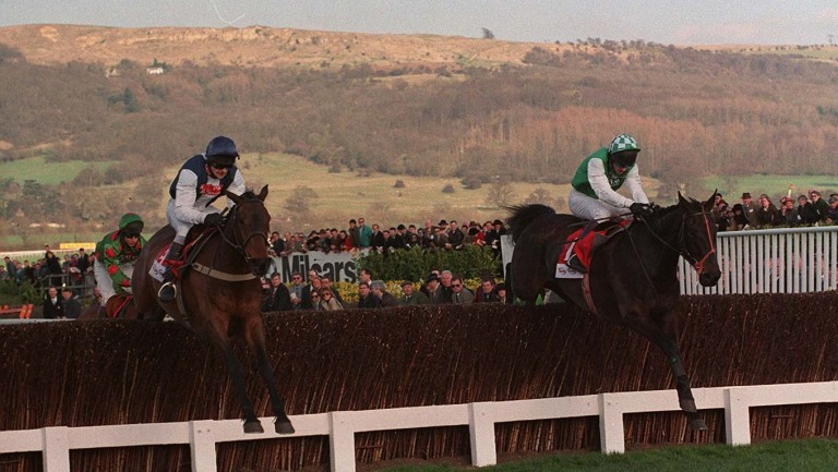 Andrew Thornton jumps the last on Cool Dawn (left) alongside Strong Promise in the 1998 Gold Cup