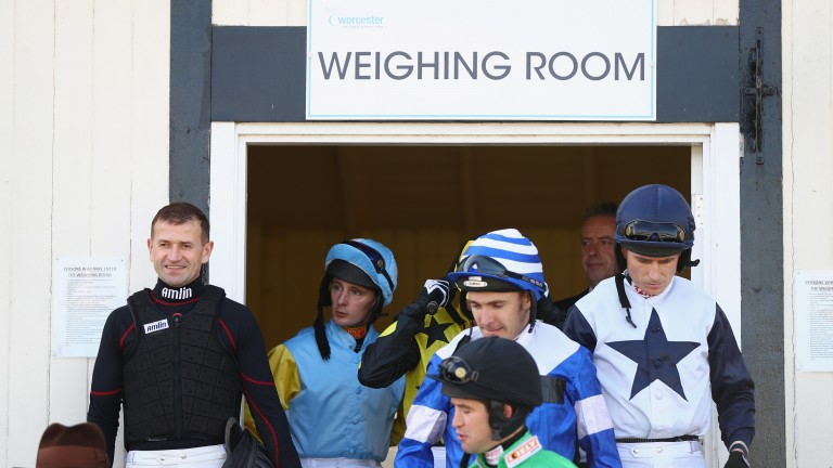 Andrew Thornton (left) with his fellow jockeys outside the Worcester weighing room