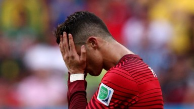 Portugal's Cristiano Ronaldo hides his face during the 2014 World Cup