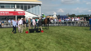 An appreciative Listowel crowd greet On The Fringe after his victory in the hunters chase