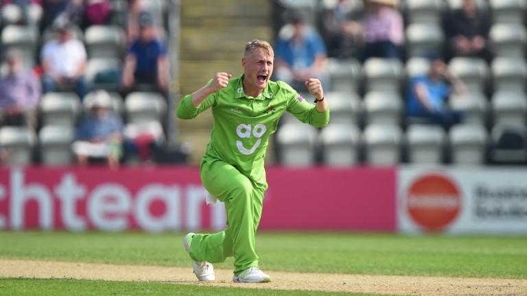 Lancashire leg-spinner Matt Parkinson celebrates a wicket against Lancashire
