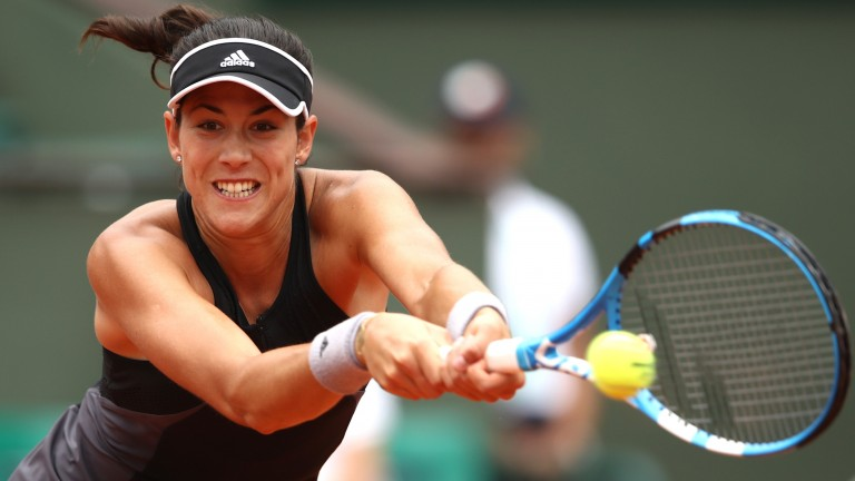 Garbine Muguruza hammers a backhand against Maria Sharapova