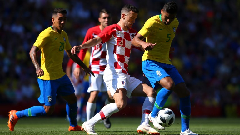 Casemiro of Brazil is challenged by Ivan Perisic of Croatia