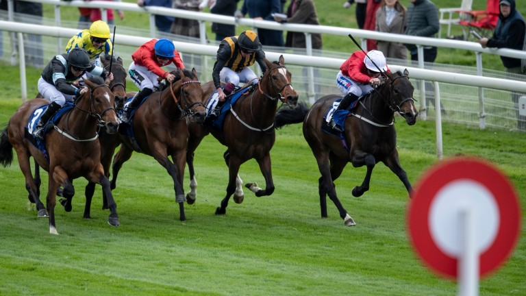 Cavatina (red silks, blue cap) delivers her challenge between horses at York last month