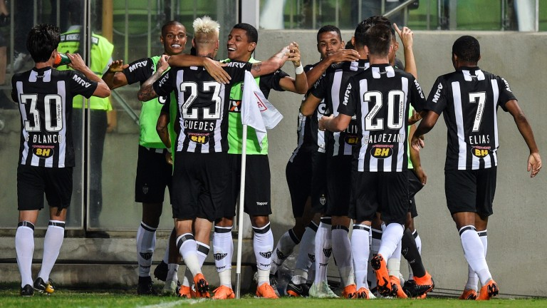 Atletico MG players celebrate a goal against Corinthians