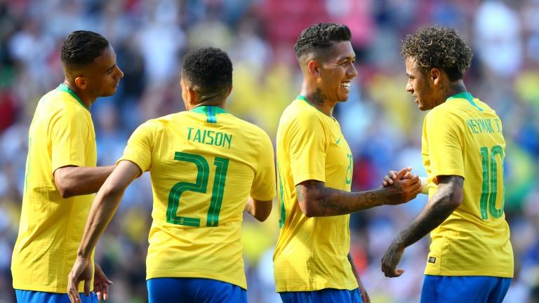 Brazil celebrate their 28th win in 30 friendlies against Croatia at Anfield