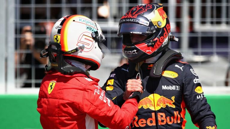 Max Verstappen (right) congratulates pole-sitter Sebastian Vettel after qualifying