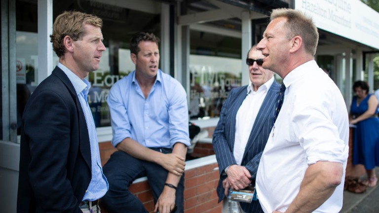 Arc chief executive Martin Cruddace speaks to trainers Jamie Snowden (left) and Charlie Longsdon (centre) at Worcester on Monday