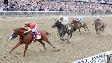 ELMONT, NY - JUNE 09:  Justify #1, ridden by jockey Mike Smith crosses the finish line to win the 150th running of the Belmont Stakes at Belmont Park on June 9, 2018 in Elmont, New York. Justify becomes the thirteenth Triple Crown winner and the first sin