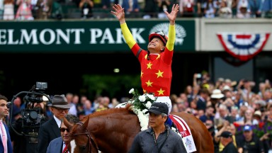 Mike Smith celebrates Justify's Triple Crown after landing the Belmont Stakes, an event that was a huge focus of sporting attention in the US