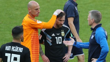 Lionel Messi is consoled by teammates after his penalty miss