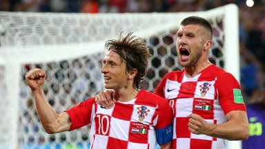 Luka Modric (number ten) celebrates with Ante Rebic