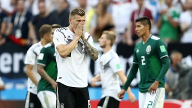Toni Kroos of Germany stands dejected after losing to Mexico
