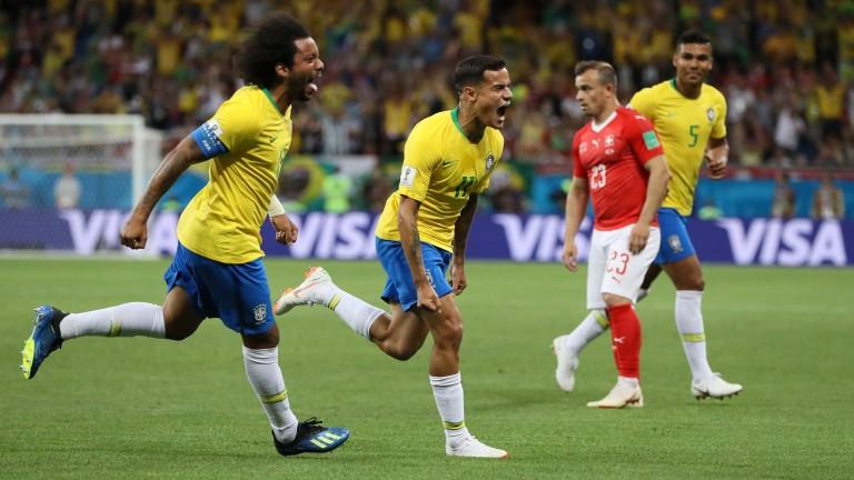 Brazil's Philippe Coutinho celebrates his goal against Switzerland