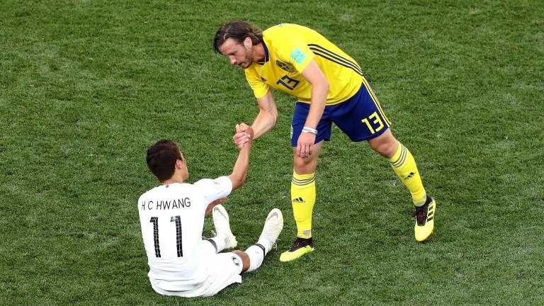 Sweden's Gustav Svensson consoles South Korea's Hee-chan Hwang
