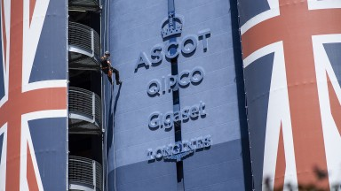 Hit the heights: a police rifle man abseils down the tower in front of the parade ring